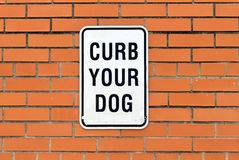 Curb your dog sign Royalty Free Stock Photo
