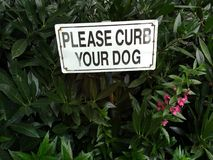 Curb Your Dog Sign Royalty Free Stock Images