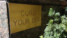Curb Your Dog Sign Stock Photo