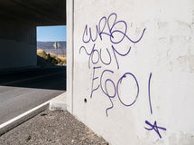 Curb your ego. Words of advice graffiti Stock Image