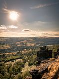 Curbar Edge Peak District. With a sunburst stock image