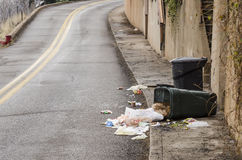 Curbside cleanup. Unsupervised rubbish making its way into a traffic zone Stock Photo