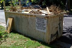 Curbside Industrial Dumpster stock images