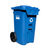 Curbside Recycle bin. Large sized blue box curb side recycling bin on wheels for mixed use (paper, plastics, glass, tins, etc Royalty Free Stock Image