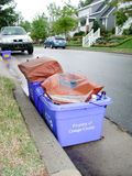 Curbside Recycling. Bins ready for pickup on recycling day on a suburban neighborhood street Stock Images