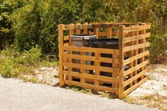 Trash bin holder made from pallets royalty free stock photo