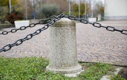 Curbstone with chains royalty free stock images