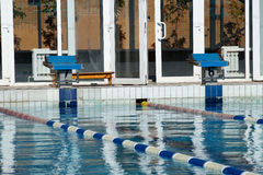 Curbstone for a jump to the pool Royalty Free Stock Images