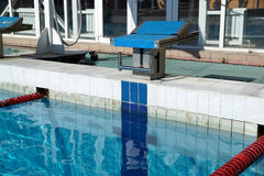 Curbstone for a jump to the pool Stock Photos
