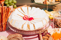 Curd cake with strawberries. Is on the table decorated with bakery products and grapes Royalty Free Stock Images