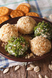 Curd cheese balls with crackers, herbs and pumpkin seeds macro. Royalty Free Stock Photo