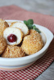 Curd cheese cakes with breadcrumbs and sweet cherry Stock Image