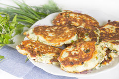 Curd cheese cakes with herbs. Salty cottage cheese pancakes with green onions Stock Photos
