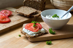 Curd cheese dip with herbs and rustic wholegrain bread with toma Royalty Free Stock Images
