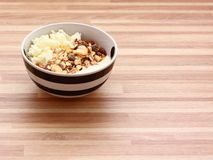 Curd cheese with muesli. A black and white bowl of a curd cheese and muesli Stock Photography