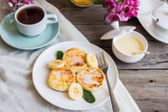 Curd cheese pancakes with banana, condensed milk and fresh mint, Stock Images