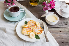 Curd cheese pancakes with banana, condensed milk and fresh mint, Royalty Free Stock Photography
