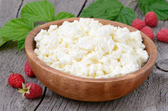 Curd cheese in wooden bowl Royalty Free Stock Images
