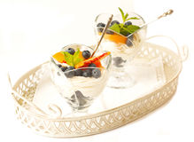 Curd dessert with fresh peaches and blueberries on white backgro Royalty Free Stock Photo