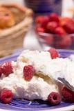 Curd dessert with fresh raspberries Royalty Free Stock Image