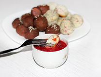 Desert curd balls with strawberry sauce Royalty Free Stock Photo