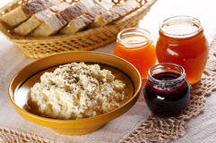 Curd with different fruit jams. And bread Royalty Free Stock Photos