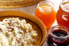 Curd with different fruit jams. And bread Stock Photography