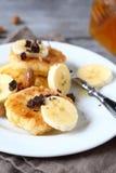 Curd pancake with chocolate and chunks banana Stock Images