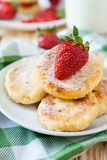 Curd pancake with milk and ripe berry Royalty Free Stock Images