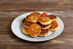 Curd pancake on white plate Stock Image