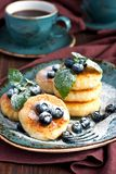 Curd pancakes with  berries and coffee cup Royalty Free Stock Images