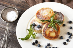 Curd pancakes with fresh berries and  decoration Stock Photo