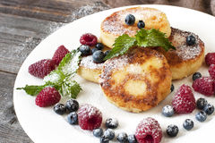 Curd pancakes with fresh berries and  decoration Stock Image