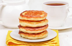 Curd pancakes stack and tea Stock Photography