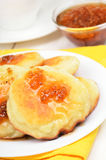 Curd pancakes with yellow raspberry confiture Stock Images