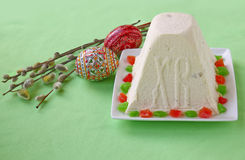 Curd paskha, easter eggs and bunch of willow twigs Stock Images