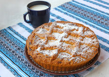 Curd pie and cup with milk Royalty Free Stock Photo