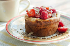 Curd pudding with berries honey and almonds. Raspberry Cheesecake with strawberry, raspberry honey and almond Stock Photos