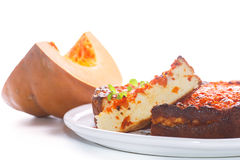 Curd pudding with chunks of pumpkin inside. Sweet curd pudding with chunks of pumpkin inside royalty free stock images