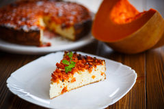 Curd pudding with chunks of pumpkin inside. Sweet curd pudding with chunks of pumpkin inside stock images