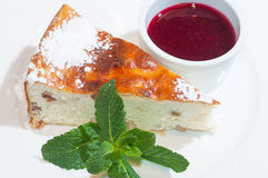 Curd pudding with raspberry sauce and mint Stock Photography
