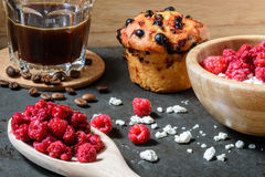 Curd with raspberries, coffee in a cup and blueberry muffin for breakfast. Cottage cheese with raspberries, coffee in a cup and blueberry muffin for breakfast Stock Photo