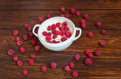 Curd with ripe raspberries. Cottage cheese with raspberry on a dark background royalty free stock photography