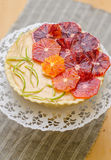 Curd tart with blood orange slices Stock Image