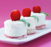 Curd Tenderness On Air Biscuits With A Strawberry Royalty Free Stock Photography