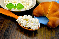 Curd on a wooden spoon on a board Stock Photo