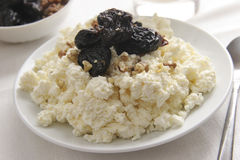 Curds for breakfast. Curds with prunes and walnuts for breakfast Stock Photography