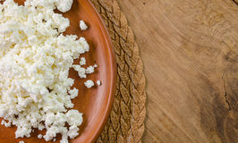 Curds on the brown plate Stock Images