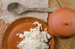 Curds on the brown plate Stock Photography