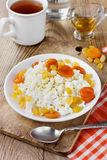 Curds with honey, raisin and dried apricots Stock Image